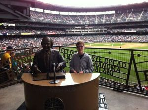 Thomas at the Mariner's game with Dave Niehaus statue