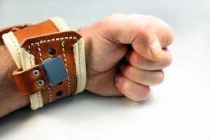 wrist restraint is applied and locked to a wrist