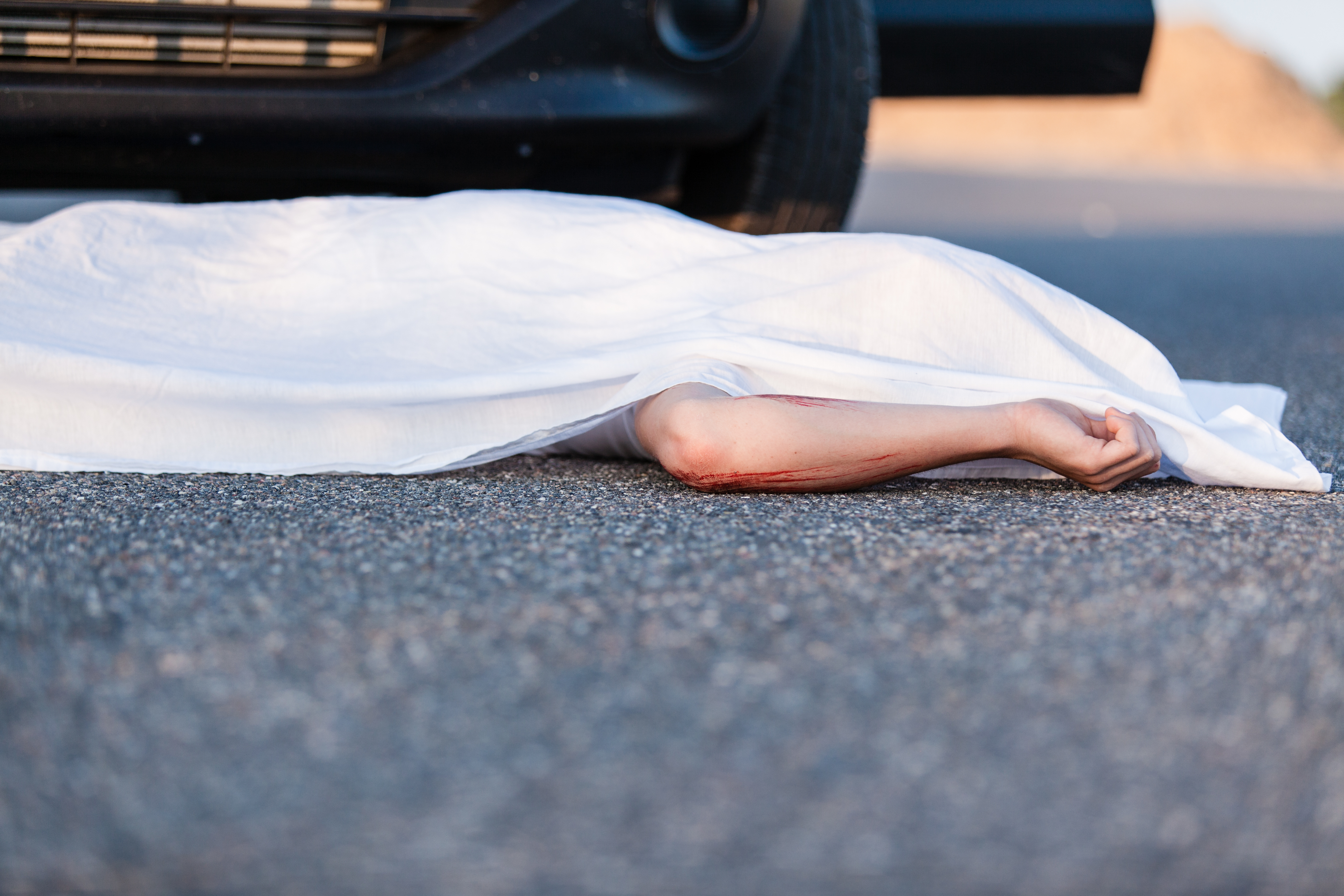 Body of a young child covered by a sheet